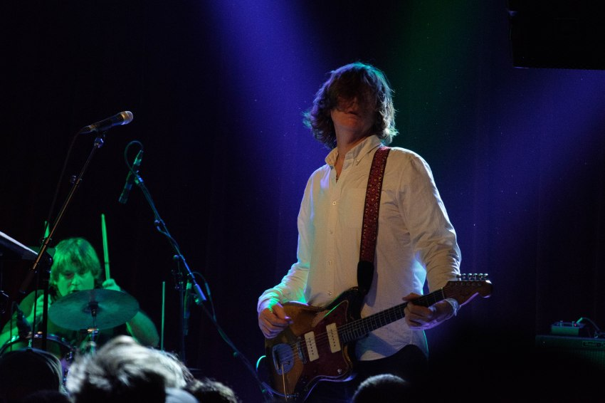 Thurston Moore and drummer looking out